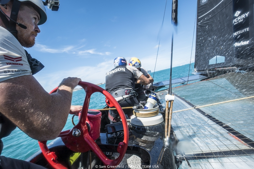 ORACLE TEAM USA tactician/helmsman Tom Slingsby at the helm during training in Bermuda.